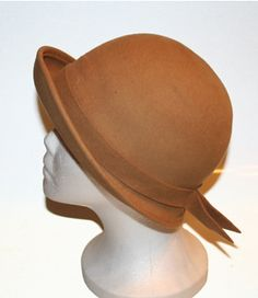 Showing off your cute, round head. Vintage Art Deco- Frank Olive, Neiman Marcus