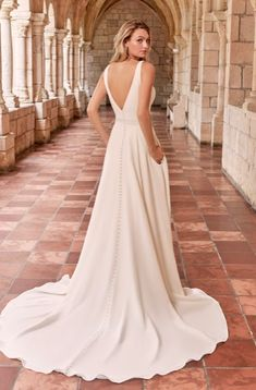 Time to end the notion that simple gowns are doomed to disappoint. This minimalist crepe A-line wedding dress is meant to be admired from every angle. Simple Wedding Gowns, Simple Gowns, Crepe Wedding Dress, Maggie Sottero Wedding Dresses, Classic Wedding Dress, Plan Your Wedding, Bridal Lace, Bridal Style, Vera Wang