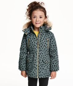 Padded parka with detachable, faux fur-trimmed hood. Zip at front, chest pockets with zip, and front pockets with flap and snap fastener. Elastication at waist and inner ribbing at cuffs. Lined.