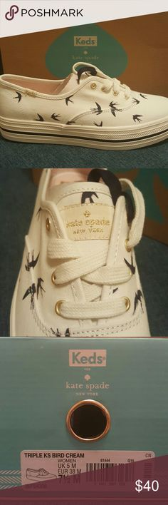 Kate spade bird Keds NWT Kate Spade Keds cream color, navy birds. Comes with navy and white laces. Gold accents. Never been worn. kate spade Shoes Sneakers