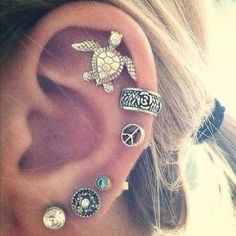 ear piercings   Tumblr  Cute,...... But....uh.....ouch! Haha I already have my first lobe done, and my second lobe done, and recently I just got my cartilage pierced! For an 8th grade graduation present I am getting my third lobes done! Yeah