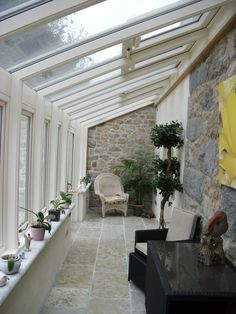 A glazed walkway opens up the side of a house. Works really well to extend a terrace.                                                                                                                                                     More