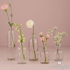 """These are the small vases. Three random per table. The tallest which is 10.5"""" would be on the console in the cocktail area only, not on the tables. One of the taller ones will also hold a staked table number so very little stem required."""