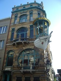 One of the art nouveau houses from the 5 Continents complex in Antwerp, built in 1901, designed by architect F. Smet-Verhas and commissioned by shipbuilder P. Rouis who requested the addition of the ship's bow to the original design. This, now protected monument, is located just behind the Royal Museum of Art in a city full of architectural inspiration.