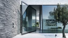 Despite its mass, it turns elegantly around its own axis. When open, it attracts astonished glances. The pivoting door is a fascinating alternative to the conventional swing door. Pivot Doors, Internal Doors, Entry Doors, Entrance, Black Window Frames, Sliding Windows, Glass Facades, High Rise Building, Safety Glass