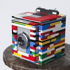 Not only a love of Lego but a love of photography as well combined in a working camera. For all the geeks in us, this design is brilliant! My lego-loving son would want to make this. Apparently you never outgrow a love of legos. Photo Lego, Legos, How To Make Camera, Pinhole Camera, Camera Art, Polaroid Camera, Camera Hacks, Lego Blocks, Lego Worlds