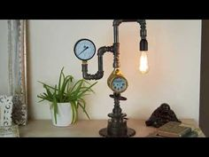 DIY Pipe Lamp Switch made with water faucet handle Pipe Lighting, Industrial Lighting, Geometric Lamp, Lamp Switch, Diy Pipe, Industrial Flooring, Metal Art Sculpture, Water Faucet, Iron Pipe
