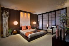 Spa style master bedroom with shoji screen and pendant bedside lamps, platform bed and twigs decor