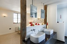 Beautiful bathroom for 2 with natural wood either side. Designed by Kerry. Get matched with the right design professional for your home project on www.designforme.com