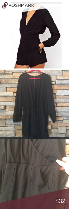"""Long Sleeve Shorts Romper New, never worn! Plunging neckline, delicate plates and pockets. The shorts have a lining so they are not sheer. Measurements are 33.5"""" in length armpit to armpit is 22"""". All measurements are approximate Shorts"""