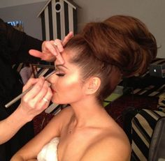 Cheryl Cole large beehive style bun, this is a lovely style. . .---- if i ever put my hair up its going to be a crazy style like this lmao