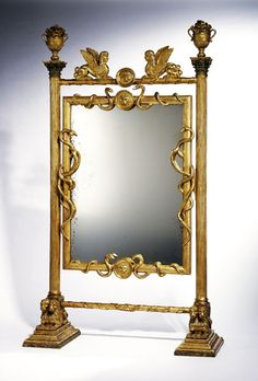 Cheval Mirror, Russia, circa 1815.  Carved wood, gilded and painted. Provenance: collection of the writer Graham Greene, Oxford.
