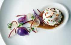 Poached duck egg with roasted onion consommé, lemon thyme and smoked duck - Simon Hulstone
