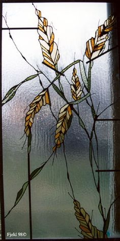 Plant life: wheat head (grain), depicted in stain glass