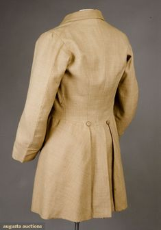 "gent's beige frock coat, 1850-1870 Wool twill, double breasted, ten woven thread buttons, waist seam and skirts, sleeves with plain cuff, center back vent with buttons above two hidden pockets in pleats, horizontal waist seam except at 4.25"" center back, mushroom silk twill lining,"