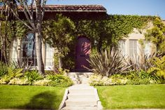 LA '20s Spanish-style house. Love the greenery and colored door.