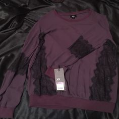 NWT Mossimo plum long sleeve top Brand new plum long sleeve top/pullover sweatshirt. Light material with lace on the sides and sleeves, sweatshirt type blend at cuffs and bottom. Fits like a small/medium since I am normally a XS/S Mossimo Supply Co. Tops Blouses