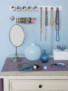 jewelry organization--I like the magnetic canisters for studs or rings. Great idea to incorporate into a hanging jewelry cabinet