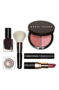 This runway-inspired set by Bobbi Brown is packed with fall trendsetters including: a bronzing duo in brownie bronzing bowder & antiqua illuminating bronzing powder, lip color in brown berry, metallic long-wear cream shadow in brown metal, nail polish in bittersweet, mini lash glamour extreme lengthening mascara in black and a mini face blender brush .