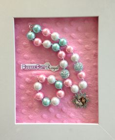 Frozen inspired bubblegum bead necklace with pink, aqua and white beads and an Elsa and Anna pendant $25 + p&h. Matching bracelet $5 with necklace purchase.
