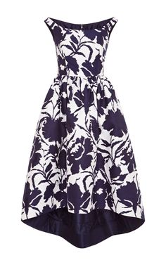 With a minimal two-tone take on floral, Oscar De La Renta's color block jacquard tea length dress is the ultimate garden party get-up. A bold, lavishly-sized print is rendered in monochrome navy and set against optic white, making the full-skirted frock overflow with graphic allure.Shop the LookStyled with Rochas pouch and Giuseppe Zanotti pumps. 81% cotton, 19% silkLining 100% silkMade in the USA