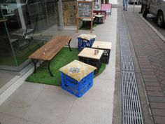 sidewalk cafe with cheap seats and green grass