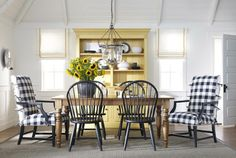 Love the mix of styles to create a layered looking dining room. Farmhouse table, painted hutch, mixed chairs.