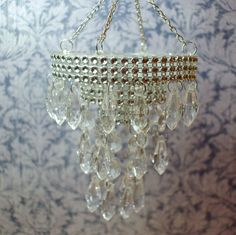 Miniature Dollhouse Faux Crystal Chandelier .....Chandelier is on the larger side of 1/12 scale. Could use in a larger dollhouse or ballroom...or you can remove the lower 2 tiers to fit standard dollhouse.