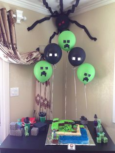 Mindcraft cake table with creeper and enderman balloons
