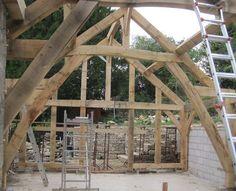Oak Frame. Curvy braces - in what will be an open plan kitchen dining area. Castle Ring Oak Frame #timberframe #oak