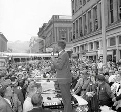 Sen. John F. Kennedy speaks to several thousand in Monument Square, Troy , Sept. 29, 1960. One girl admirer climbed a pole to get a better look.