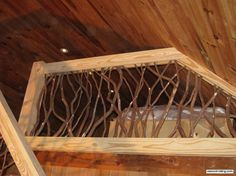 Yellow Pine Railing with Mountain Laurel Woven Branches expertly joined to a tongue-in-groove wood ceiling.