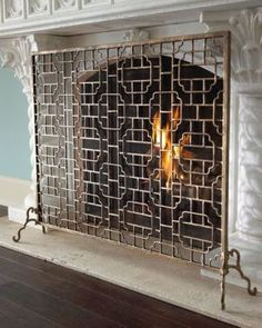 Decorating fireplaces - Wood burning - antique fire screen.jpg
