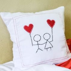 All you need is basics of embroidery and sewing to make this adorable pillow cover for your loved one.