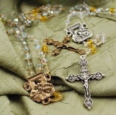 """The Year of Faith rosary made in Italy by Ghirelli in both gold and silver, $59.95. Includes the emblems of the authors of the four Gospels on the crucifix, and the centerpiece features the famous Renaissance art piece entitled """"The Incredulity of Saint Thomas"""" by famous Italian artist Caravaggio. #CatholicCompany"""