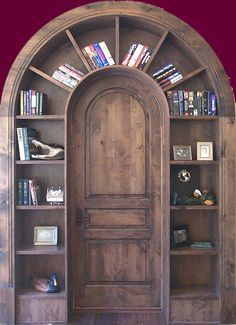 Rounded door and over the door bookshelf. Ours would need to be rectangular, but could build out frame, add moldings, and include narrow storage cupboards with hinged cabinet doors above the closet and room door.