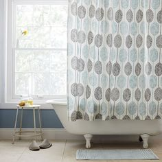 We translated a hand painted watercolor by one of our designers onto this cotton Dot Medallion Shower Curtain. Soft and subtle, it features a modern medallion motif.