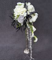 All That Jazz  by John Hosek    Flowers and Materials Featured: Hydrangeas, Roses, Spray Roses, Freesia, Mini Callas, Rhinestones, Brooches, Feathers and Beads.