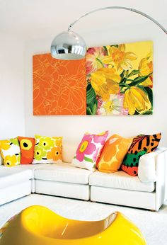 No interior colour can cheer you up like yellow. Mix with orange for a fresh #floral combination. #livingroom #brights