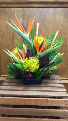 Tropical mix of birds of paradise, yellow pin cushin protea & mix of foliage Tropical Vases, Tropical Floral Arrangements, Large Flower Arrangements, Tropical Flowers, Exotic Flowers, Floral Centerpieces, Purple Flowers, Beautiful Flowers, Lilies Flowers