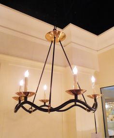 a collaboration between Barry Goralnick  and Visual Comfort produced this beautiful chandelier. love the simple wave and brass + black #hpmkt