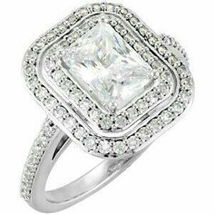 14Kt. WG Double halo diamond engagement ring.