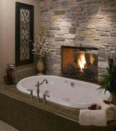 stone fireplace between master and bathroom