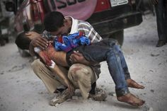 """A Syria man cries while holding the body of his son"": this unfortunately event shows the horrors of war providing the massage that war kills innocent people. This  image won  the 2013 Pulitzer Prize in Breaking News Photography. http://www.rsvlts.com/2013/09/11/syria-war-images/  http://www.slideshare.net/Fadesire123/tope-mi"