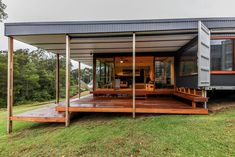 A sloped site lent itself to diff. levels inside and out. Covered deck and overhanging eaves create outdoor spaces all year round. Shipping Container Home Designed For Sustainable Family Living Shipping Container Home Designs, Container House Design, Container Houses, Shipping Containers, Staircase Handrail, Building A Container Home, Small Space Design, Indoor Outdoor Living, Outdoor Spaces