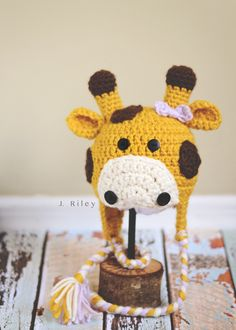 Crochet Giraffe Baby Hat. Inspiration image but the free pattern can be found at Repeat Crafter Me.