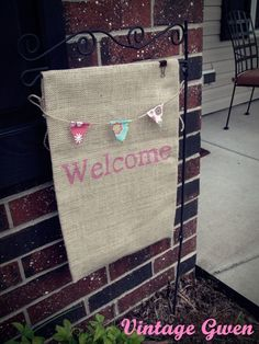 1. Love the homemade burlap flag 2. how smart to clip it down! I'm still sad my Christmas flag blew away & this would keep me from losing anymore