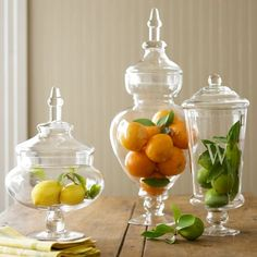 I  have jars close to these that are filled with candles and seashells, sand and a chunk of coral and orange ceramic orbs on my bedroom dresser. These jars would be great in the bathroom, too!