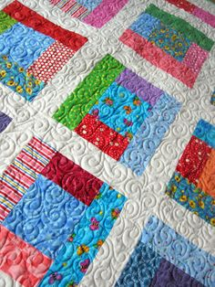 baby quilt idea with brights. Pinning because I like the quilting pattern.