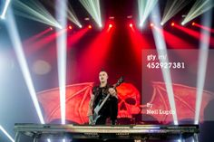 News Photo: Johnny Christ of Avenged Sevenfold performs on stage Wembley Arena, Dec 2013 | Getty Images